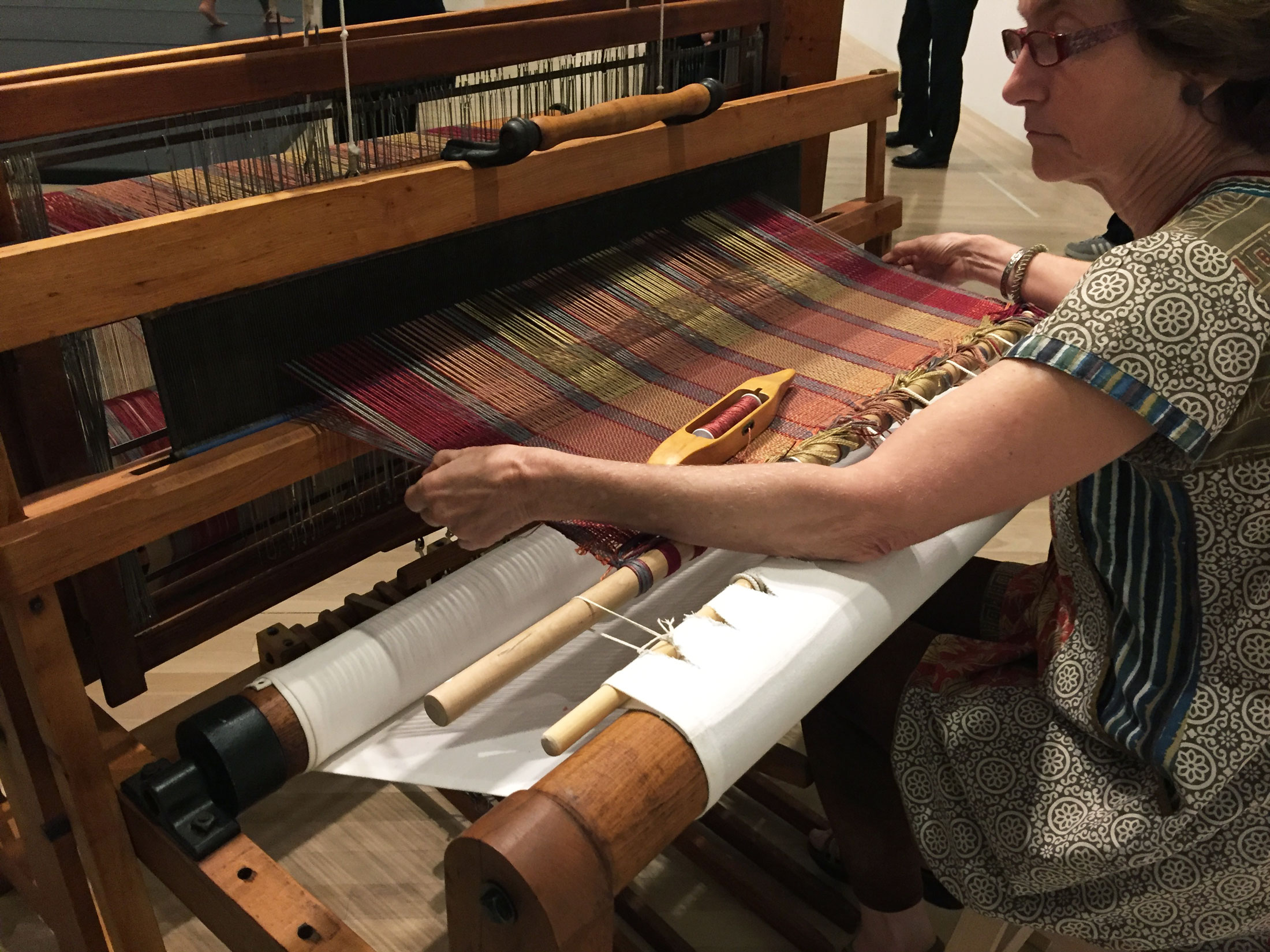 Professional weaver Cameron Taylor-Brown demonstrated the process of loom weaving using Anni Albers's Shuttle-Craft Practical Loom