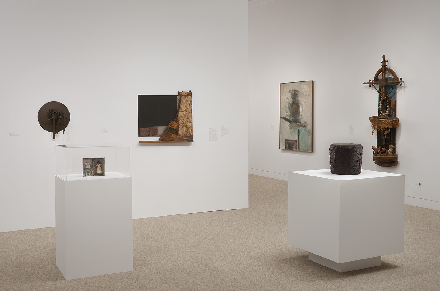 "Standing from left to right: Betye Saar, ""Imitation of Life,"" 1975 and Houston Conwill, ""Drum,"" c. 1975–80; left wall from left to right: Melvin Edwards, ""Double Chain,"" 1966 and Dale Brockman Davis, ""Swept,"" 1970; right wall from left to right: John Altoon, ""Portrait of a Spanish Poet,"" 1959 and Gordon Wagner, ""Between Heaven and Hell,"" 1960–65. Installation view at the Hammer Museum, Los Angeles"