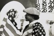 "David Hammons in his Los Angeles studio, 1970. ""Pray for America,"" 1969, is shown at left and a portion of ""Wine Leading the Wine,"" c. 1969, is visible at right"