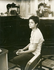 Fig. 1. Dilma Rousseff at the military audit headquarters, Rio de Janeiro, November 1970. Officers questioning her about her participation in the armed struggle conceal their faces with their hands