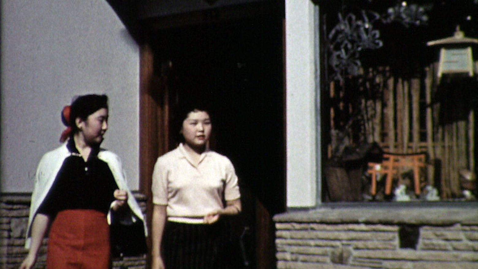 Still from the film The Challenge (1957) showing two young girls walking