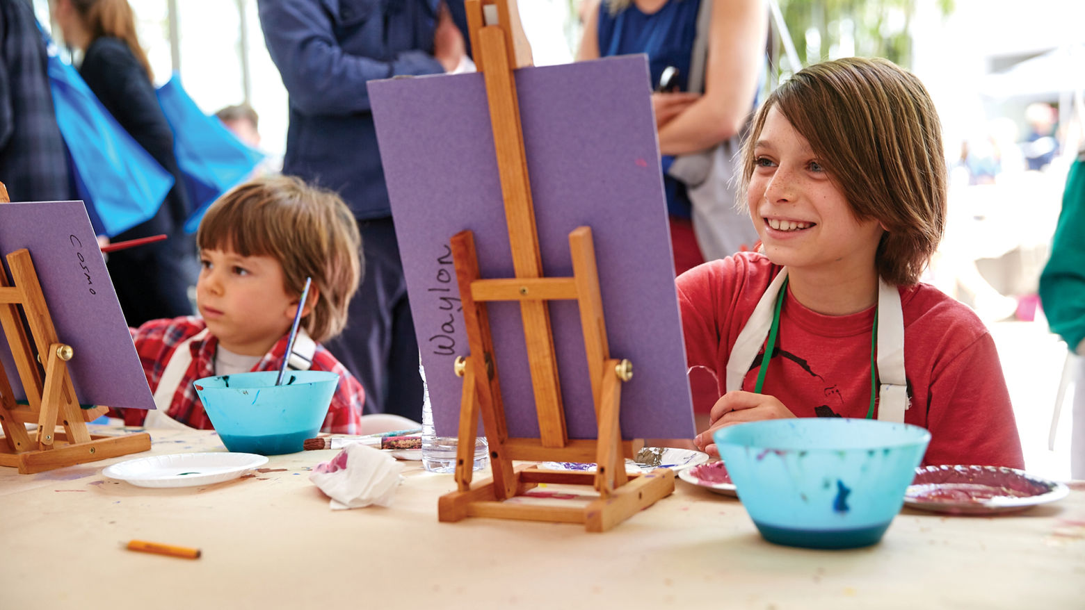 Two children paint at easels