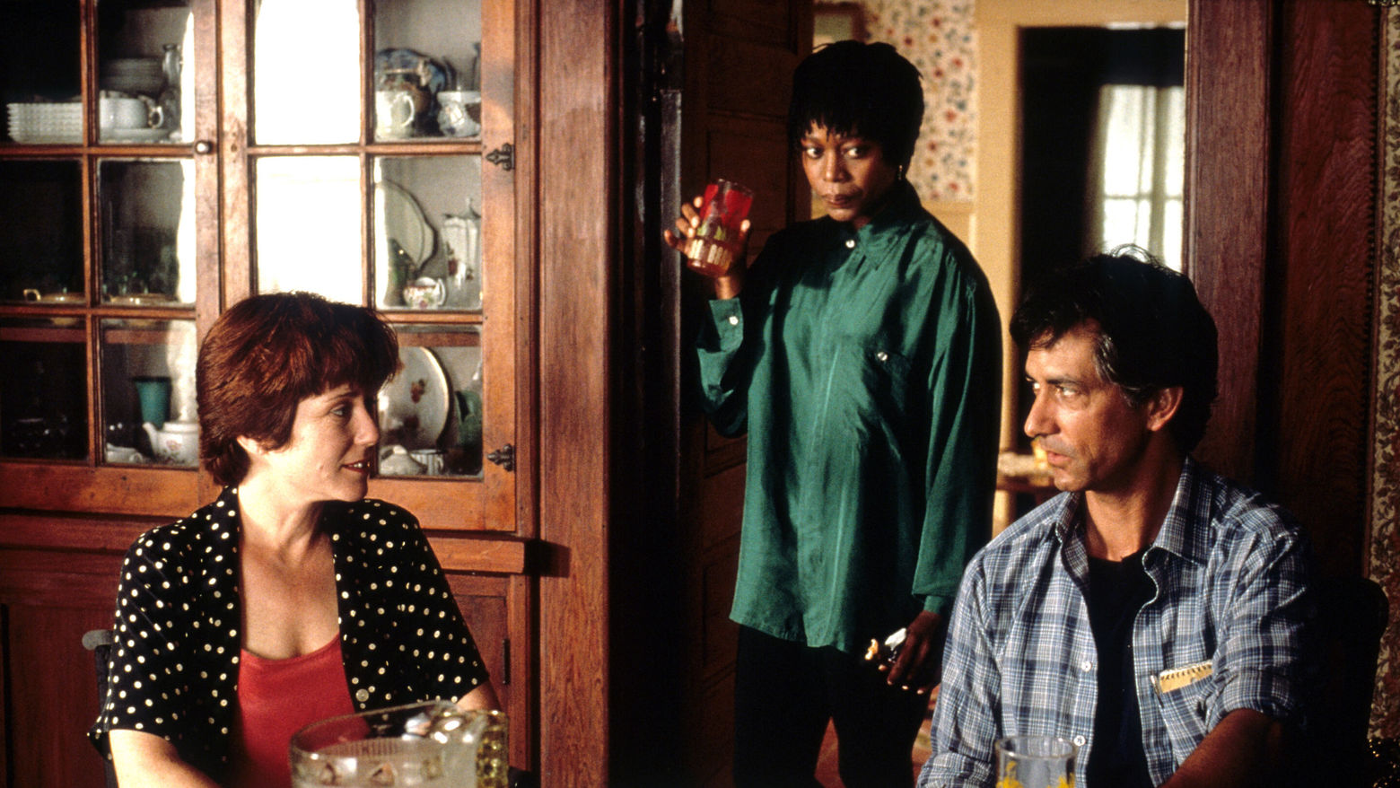 Still from the film Passion Fish (1992) showing a three people talking in a kitchen