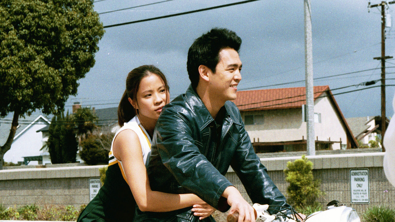Still from the film Better Luck Tomorrow (2003) showing a young Asian American couple riding a motorcycle