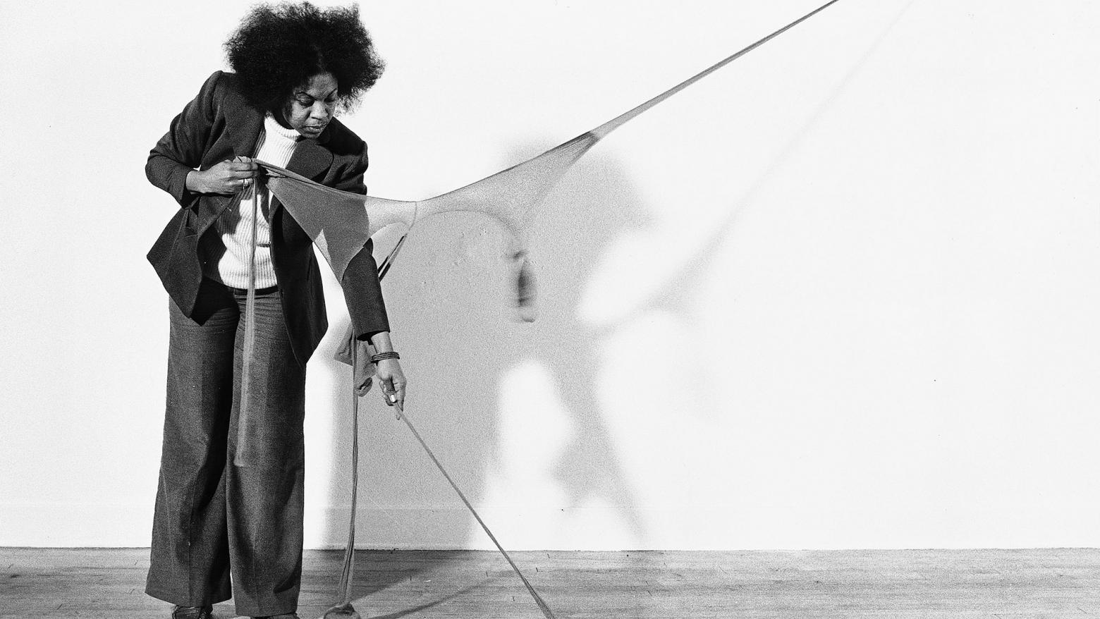 "Senga Nengudi setting up for a performance of ""RSVP X"" in her Los Angeles studio, 1976"