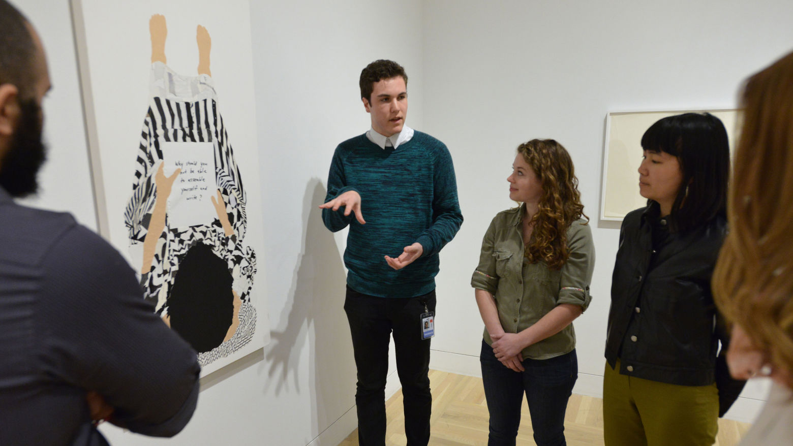 Student educators teaching in the gallery