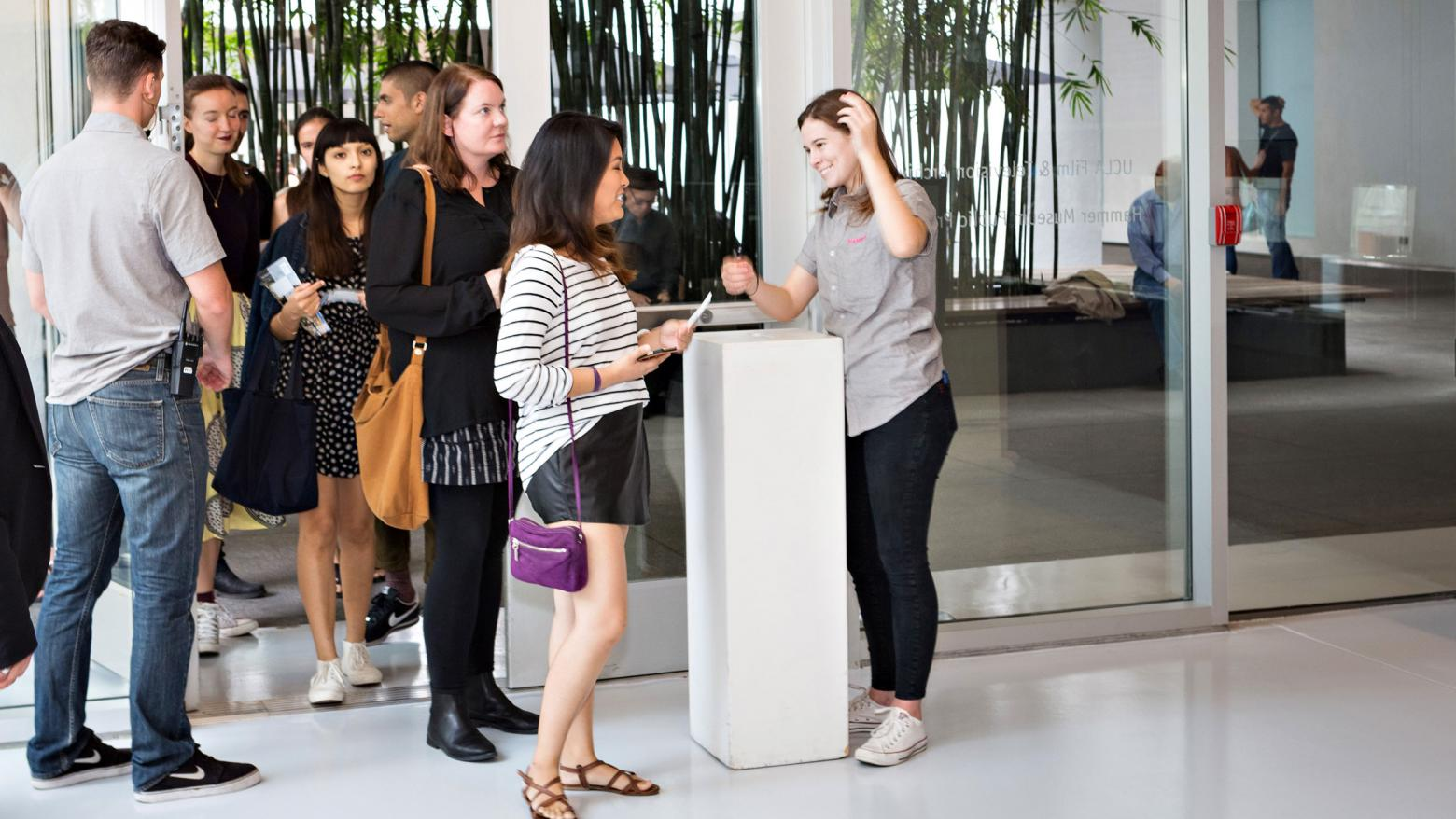 Visitors enter the theater at the Hammer Museum
