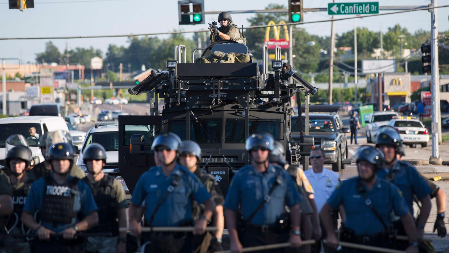 RIOT POLICE STAND GUARD DURING PROTESTS OF THE 2014 SHOOTING DEATH OF MICHAEL BROWN IN FERGUSON, MISSOURI. PHOTO: REUTERS/MARIO ANZUONI