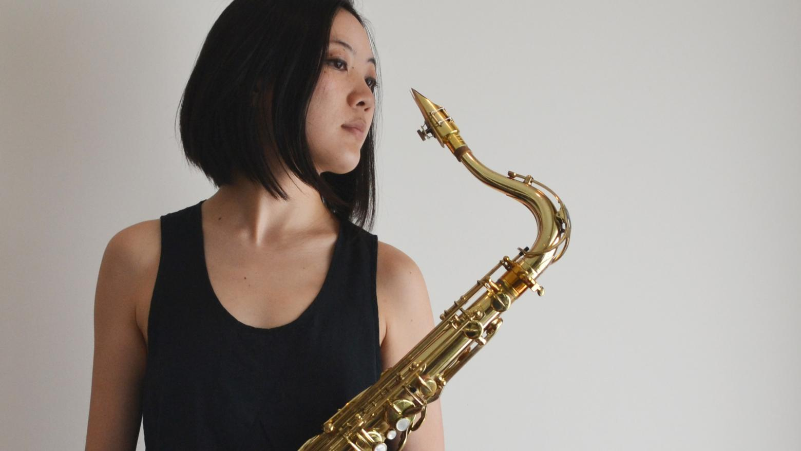 Hitomi Oba photograph, with brass instrument