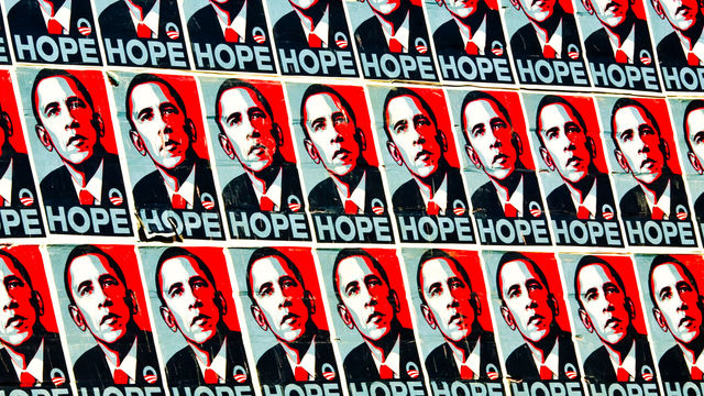A wall covered in posters for President Obama