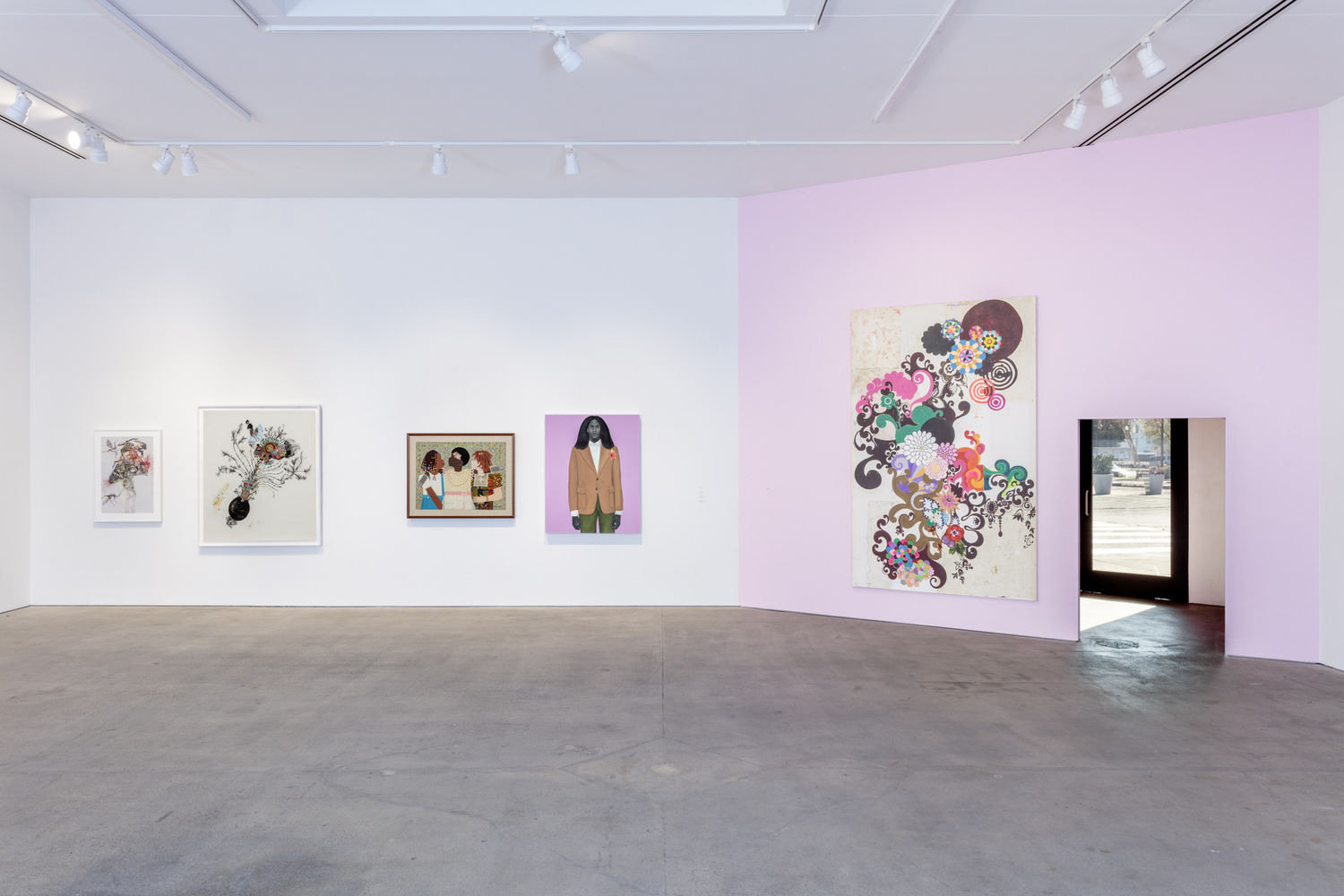 A gallery with a white and a pink wall with five artworks hanging