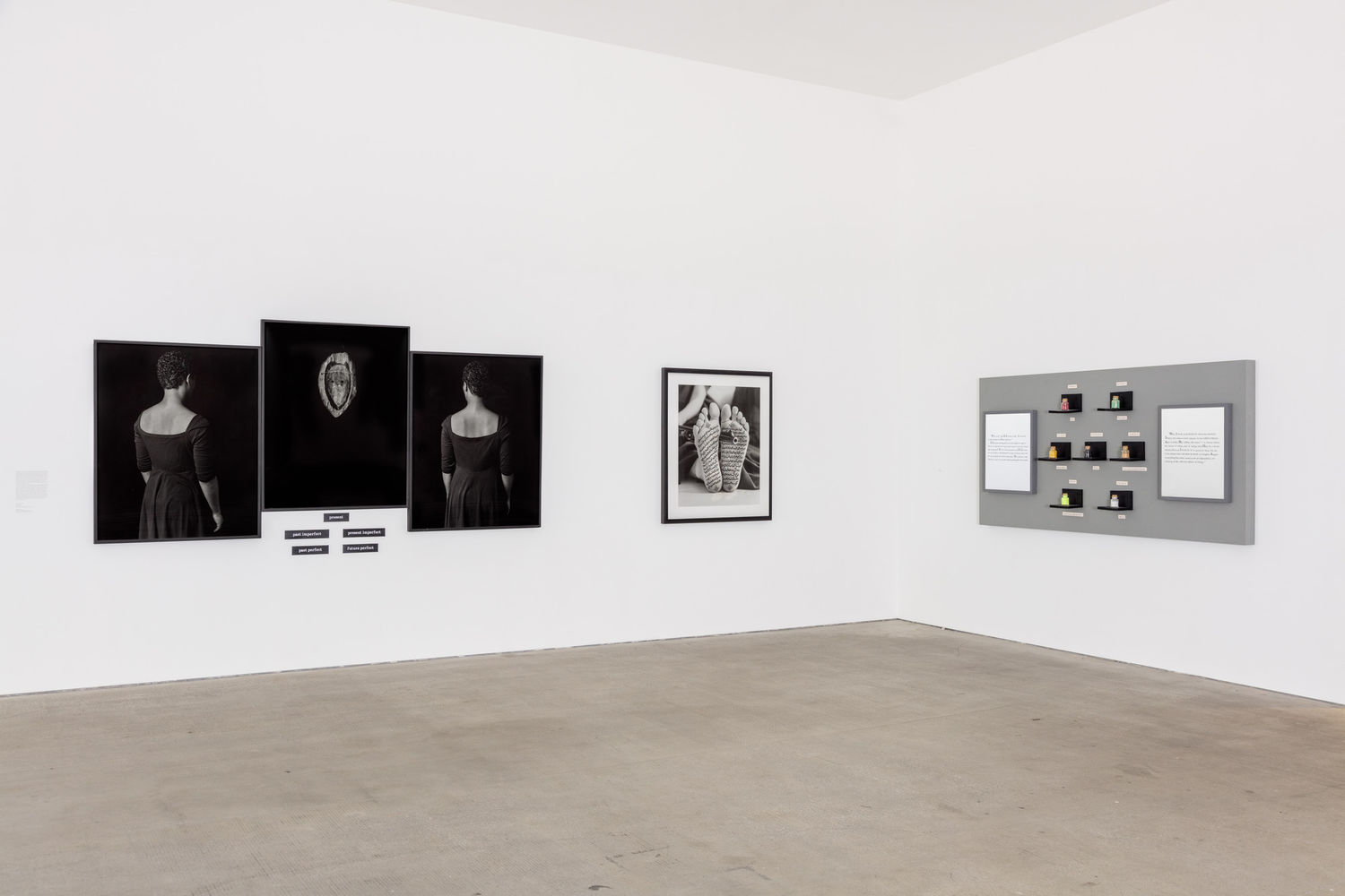 A white-walled gallery with several works hanging