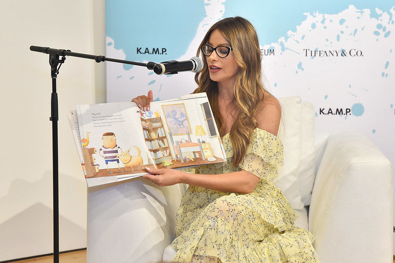 Actress Sofia Vergara reads from a book