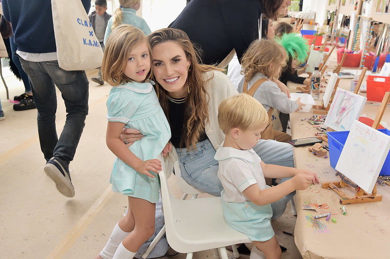 Elizabeth Chambers holds her two children