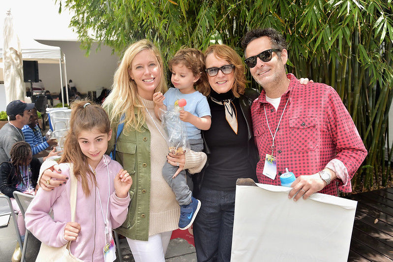 A family poses with Hammer Museum director Ann Philbin