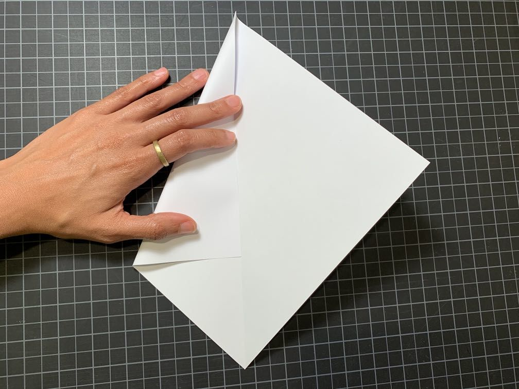 Folding paper to continue triangle