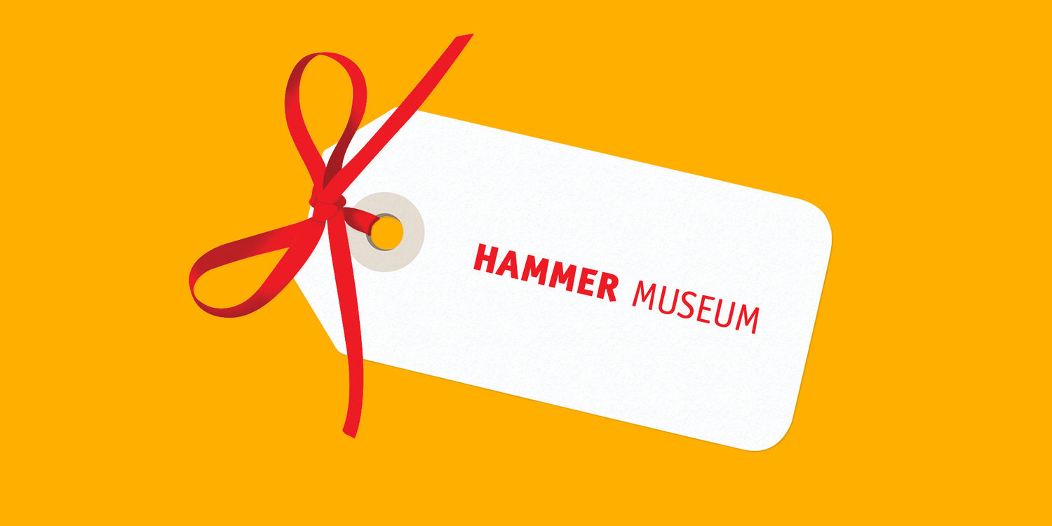 A white gift tag reading HAMMER MUSEUM on a yellow background