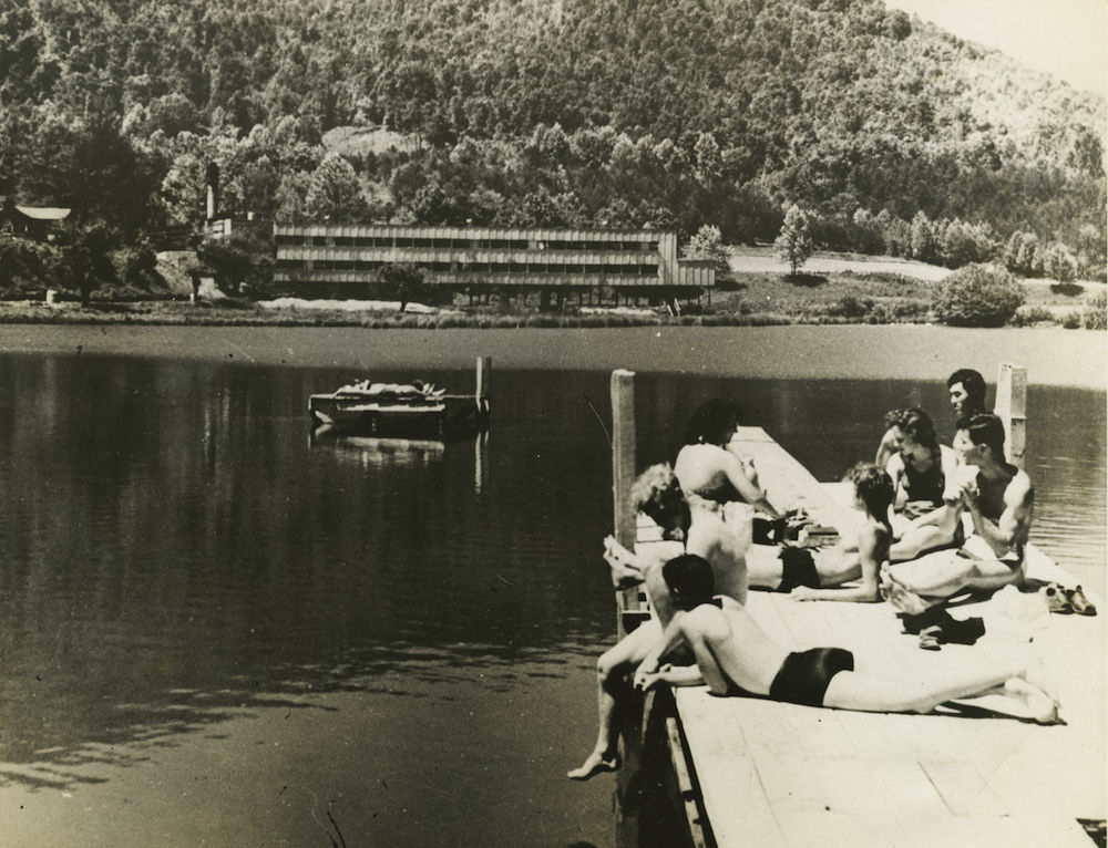 Students lounging on dock, Lake Eden, n.d. Photo by John Campbell.
