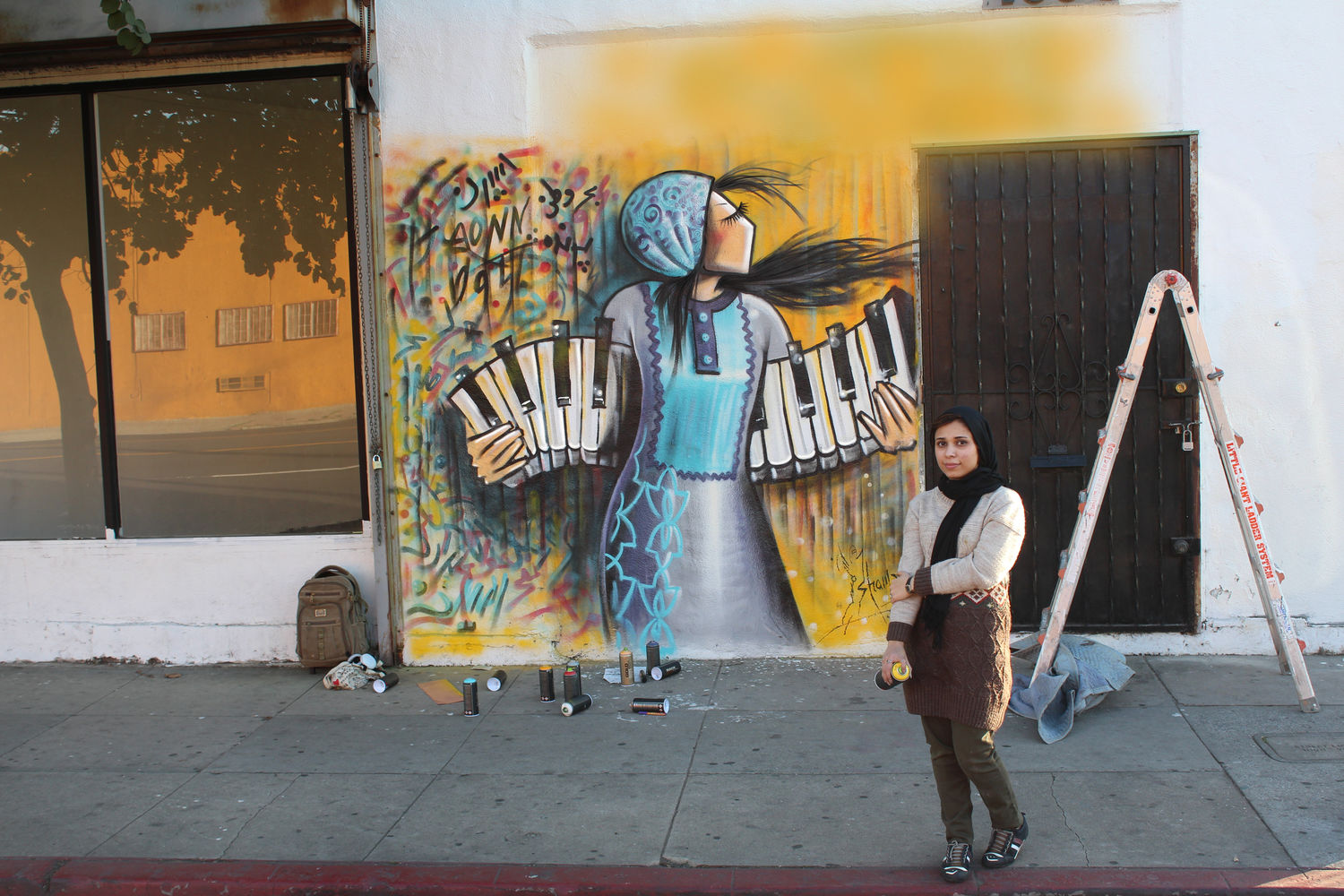 Shamsia Hassani, mural on the exterior of 4900 Gallery on West Adams Boulevard