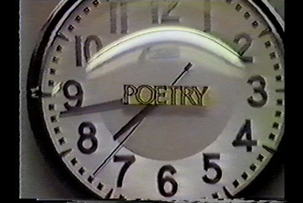 A film still of a clock with the word 'poetry' over its face