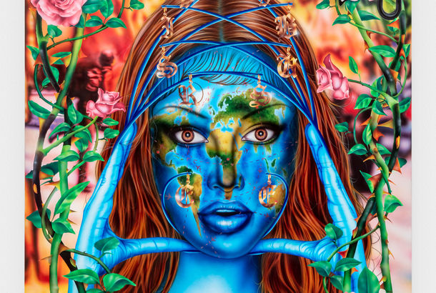 A colorful painting of a woman whose face is the earth, with the words Earth Angel above her head