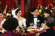 Still from the film The Wedding Banquet (1993) showing a wedding party at a dining table