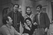 Still from the first episode of the television show Canción de la Raza (Song of the People) (1968), showing a Chicanx family gathered around a table