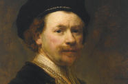 A portrait of a man with facial hair in a black hat