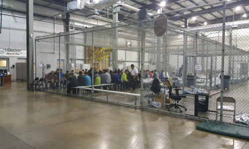 Detainees in a fenced in area inside a detention facility in McAllen, Texas.