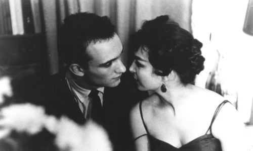 Still from the film Shadows (1961) showing a couple leaning in toward each other