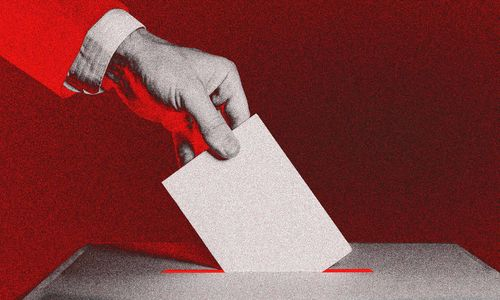 A red-tinted graphic of a hand dropping a piece of paper into a ballot box