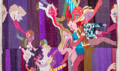 A purple tapestry of cartoonish, scary figures