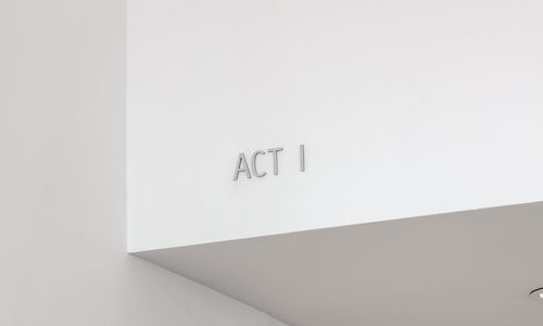 A white ceiling corner with ACT I embossed on it