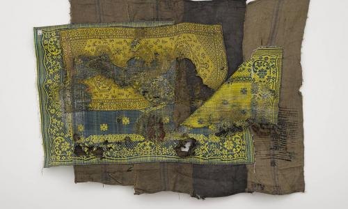 Ibrahim Mahama, ALIJA X, 2015-2016. Sleeping prayer mats melted on coal sacks, 90 9/16 × 114 9/16 in. (230 × 291 cm). Hammer Museum, Los Angeles. Purchased with funds provided by Beth Rudin DeWoody. ©Ibrahim Mahama