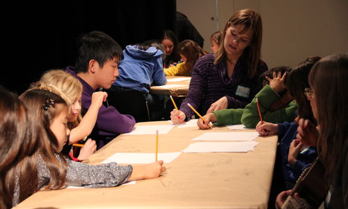 Kids work on writing in an 826LA writing workshop at the Hammer Museum.