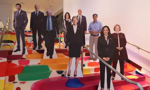 Cardboard cutouts of several 2020 Democratic candidates stand on the Hammer's lobby staircase.